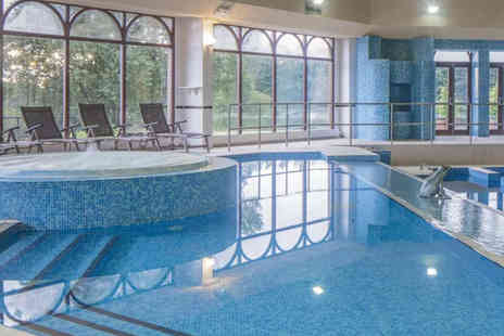 Doubletree by Hilton Glasgow Westerwood Spa & Golf Resort - 25 minute Elemis spa treatment, spa access for one, a glass of bubbly and a £10 voucher to spend on additional treatments or Elemis products - Save 43%