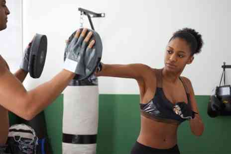Impact Kickboxing - Four Lessons of Kickboxing - Save 50%