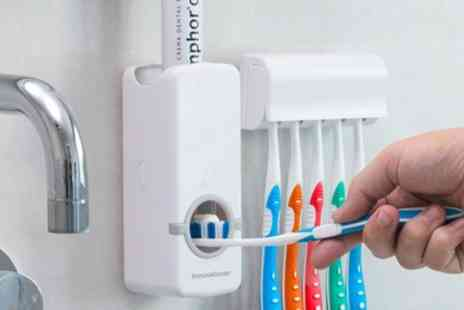 Groupon Goods Global GmbH - Up to Four Toothpaste Dispensers with Brush Holder - Save 0%