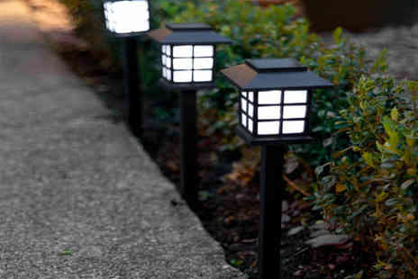 Gift Gadget - Pack of 12 solar powered garden lanterns - Save 68%