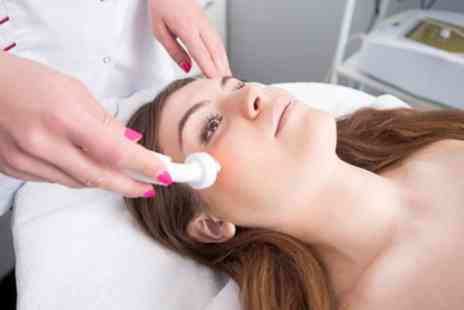 SoliDerma - One Hour Express Facial with Led Light Treatment and Face and Shoulders Massage - Save 51%