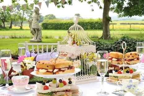The Wroxeter Hotel - English Garden themed afternoon tea for two people with a glass of sparkling wine each - Save 52%