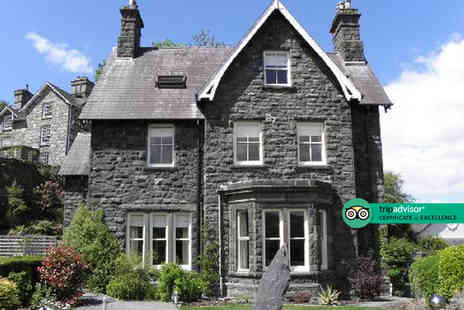 Ffynnon - Five Star Overnight stay for two with breakfast, bottle of Prosecco, private hot tub access and chocolates - Save 23%