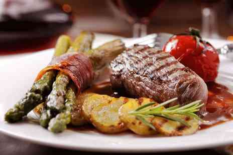Esca - Fillet steak dining for two people with a glass of house wine each - Save 0%