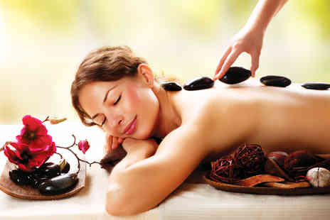 Wellness & Beauty Clinic - 60 min hot stone massage and consultation - Save 73%