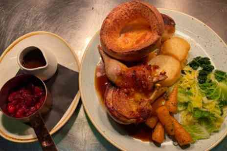 The Clock N8 - Michelin Listed Three Course Sunday Roast with Prosecco for Up to Four - Save 32%