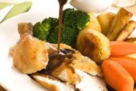 The Holiday Inn - Sunday carvery for two and enjoy a delicious roast with dessert and tea or coffee - Save 60%