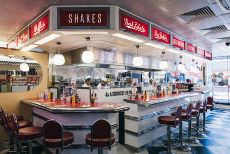 Giraffe - Dinner for two at Eds Easy Diner including a burger or hotdog, side and drink each - Save 53%