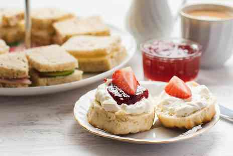 The Bridge Hotel & Spa - Afternoon tea for one person including a glass of bubbly - Save 46%