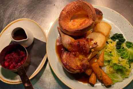 The Clock N8 - Three Course Sunday Roast with Prosecco for Up to Four - Save 42%
