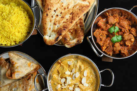 The Ashoka - T0hree course a la carte Indian meal for two with a glass of house wine or soft drink each - Save 69%