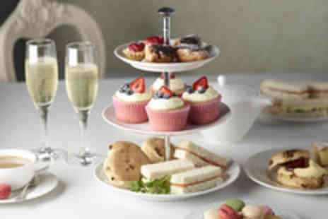Indulgence - Afternoon tea for 2 inc. scones, sandwiches, cakes & a glass of bubbly - Save 53%