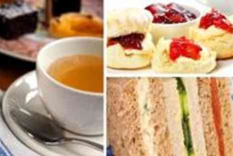 Hotel Russell - Quintessential afternoon tea for two including finger sandwiches, pastries and scones - Save 61%