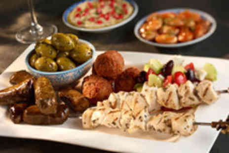 Karaam - Eight hot or cold mezze dishes for 2 plus a glass of house wine - Save 58%