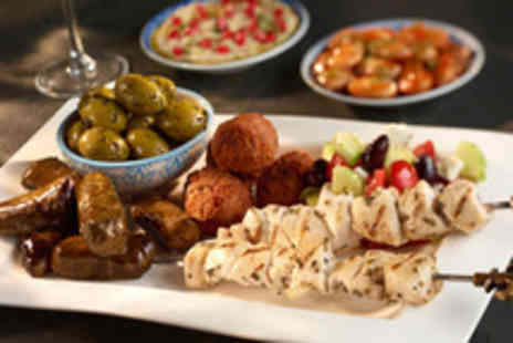 Karaam - Eight hot or cold mezze dishes for 2 plus a glass of house wine - Save 65%