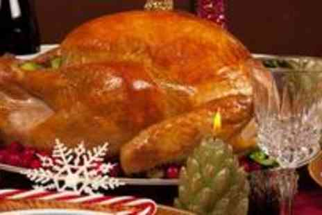The Village Inn - Three course festive meal for four - Save 64%