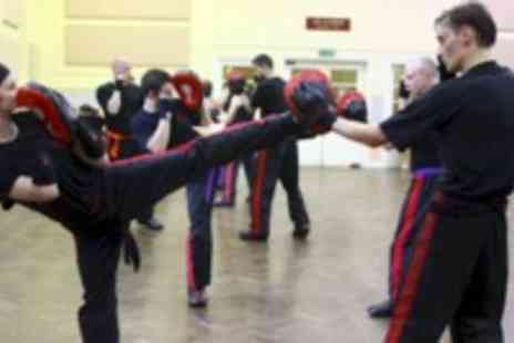KB Fitness - Two kickboxing classes and one self defense class - Save 40%