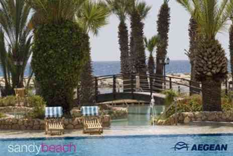 Sandy Beach Hotel - Four Night Half Board Stay in Cyprus For Two People With Return Flights - Save 51%