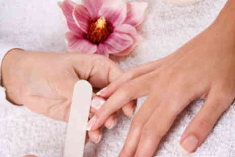 Nail Xpression - Fish Pedicure or Hand Paraffin Manicure - Save 55%