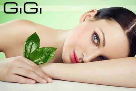GiGi London Medical Aesthetics - Microdermabrasion or Glycolic Skin Peel With Facial and Massage - Save 82%