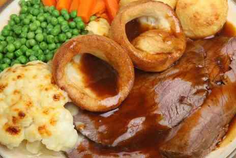 The Village Inn - Delicious Sunday lunch including dessert and coffee for two - Save 50%
