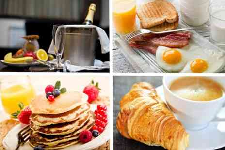 The Axis Bar and Restaurant - All you can eat Champagne breakfast for 2 - Save 54%