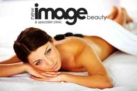 New Image Beauty and Specialist Clinic - Hot Stone or Aromatherapy Massage - Save 63%