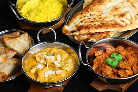 Saffrani - Two main courses, two rice sides, two naan and two bottles of Cobra beer or soft drinks - Save 21%