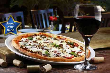 Ciao Italia - Italian meal for two serving up two 12 pizzas with a Bellini cocktail or a glass of wine - Save 50%