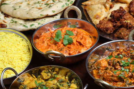 Raj Restaurant - Indian meal for 2 including starters, mains, sides and glass of wine or beer - Save 53%