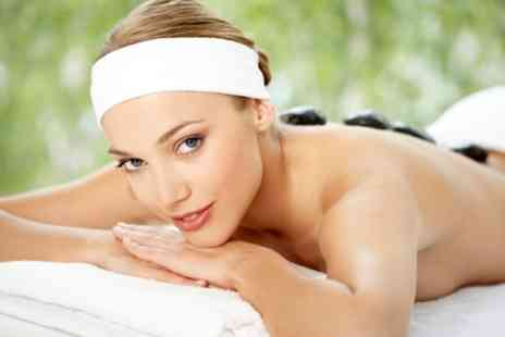 The Essence of Beauty - Hot Stone Back Massage and Facial - Save 62%