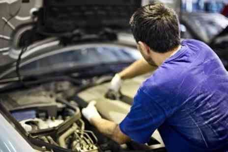 We Fix N E Car - 32 Point Service With Oil Change - Save 51%