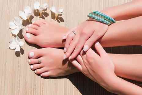 Absolute Health and Tanning - Manicure and Pedicure - Save 61%