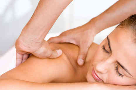 Holistic Harmony - 30 Minute Swedish Aromatherapy or Hot Stone Massage - Save 57%