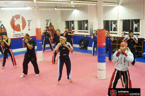 Nottingham School of Blackbelts - Two Month of Kickboxing or Mixed Martial Arts Classes - Save 80%