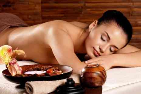Cosmetic Body Clinic  - Massage Facial and Body Wrap or Scrub - Save 76%