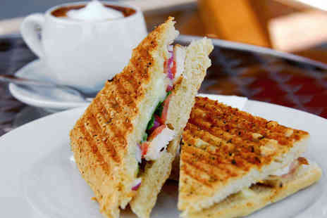 The Old Tea House - Two Paninis Two Desserts and Two Teas or Coffees - Save 50%