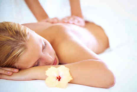Cyan BeautyStudios - Hour Long Deep Tissue or Hot Stone Massage - Save 58%