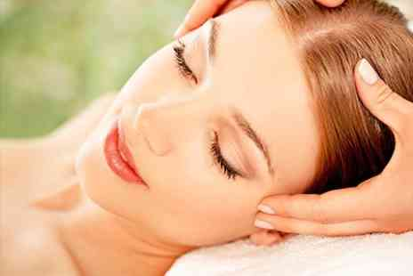The Essence of Beauty - Facial, Hot Stone Back Massage, and Scalp Massage - Save 62%