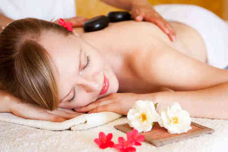 The Cottage - Hour Long Aromatherapy Hot Stone Swedish or Deep Tissue Massage - Save 55%