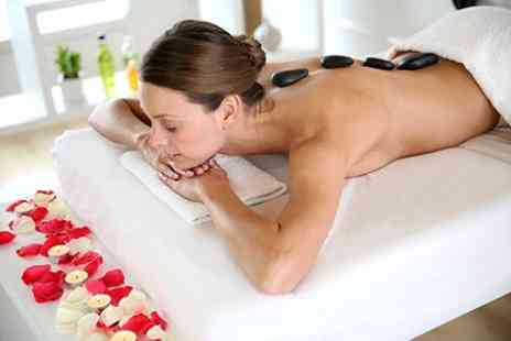 Xanadu - Swedish or Hot Stone Massage and Facial - Save 50%