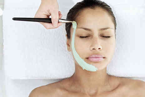 Sandra Kelly's Beauty & Tanning - Deluxe Facial with Head and Neck Massage - Save 60%