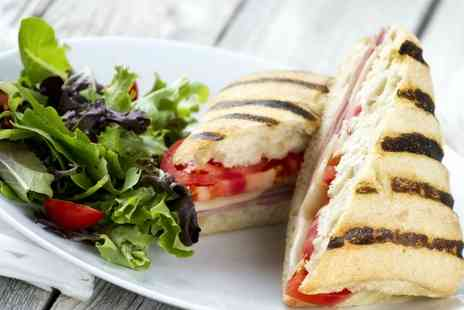 Lounge Restaurant - Gourmet paninis and hot drinks for two people - Save 53%