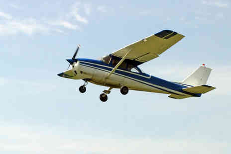 Almat Aviation - Flying Experience with Lesson and Flying Time - Save 55%