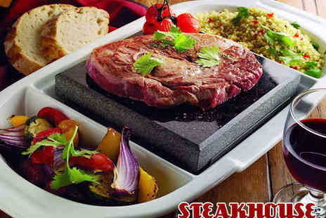 Steakhouse - Hot Stone Steak Meal with Chips Salad and Glass of Wine Each or Bottle of Beer for Two - Save 53%