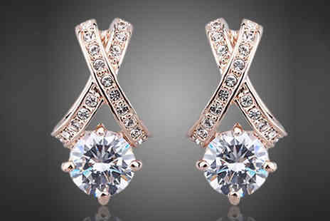 Spa Shopping - Pair of gorgeous criss cross diamond earrings - Save 87%