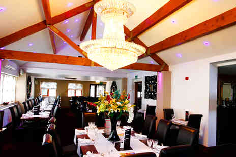 Ashiana Indian Restaurant & Hotel - Two Course Indian Meal with Sides for Two - Save 56%