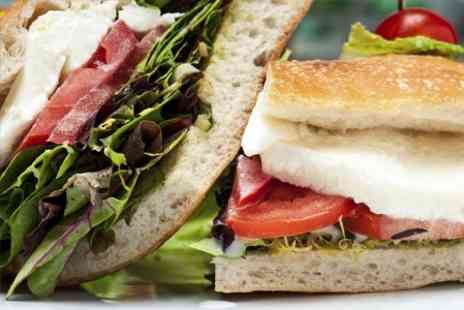 The Village Deli - Bagel Sandwich or Panini With Coffee For Two - Save 52%