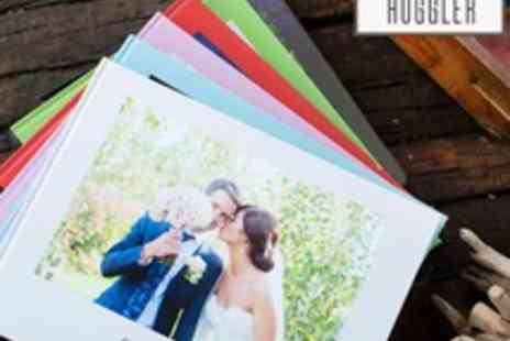Huggler - Voucher for a Choice of 50 or 100 Page Personalised Photo Book - Save 65%