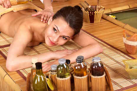 Studio 75 - Choice of Hour Long Massage Including Hot Stones Aromatherapy Swedish Sports or Injury - Save 53%